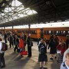 Commuters disembark from the train on Walk to Work day last month. ODT files