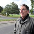 Concerned resident Paul Sorrell at the site of Tuesday's truck crash at the bottom of Pine Hill...