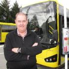Connectabus owner Ewen McCammon stands beside a new 41-seat Connectabus which entered service...