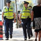 Constable Ben West (left) and Constable Jo Ammundsen walk along George St yesterday afternoon....