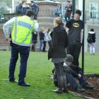 Constable Richie Ellwood, of Dunedin, speaks to two witnesses after a confrontation in the...