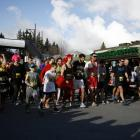 Contestants begin at a relaxed pace in the Golden Mile race at the Queenstown Winter Festival on...