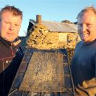 Contractor Gus Gordon (left) and farmer Ben Falconer display some of the proceeds from their gold...