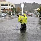 Contractors clear a blocked drain in Harbour Tce, Dunedin, about 11.30am yesterday. Photo by ...
