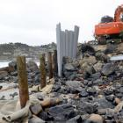 Contractors fit plastic sheet piling to St Clair's storm damaged temporary boat ramp yesterday....