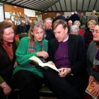 Controversial United States cleric Bishop John Spong chats with Dunedin women (from left) Ann...