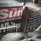 Copies of The Sun newspaper are displayed at a kiosk in London.  Rupert Murdoch is under pressure...