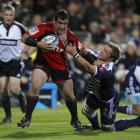 Cory Flynn of the Crusaders is tackled during the round eight Super 15 match against the Stormers...