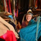Costume mistress Margaret Jackson with some of the wares available for hire from the Taieri...