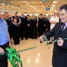 Countdown Dunedin South store manager Paul Wallace and his staff watch Dunedin Mayor Dave Cull...