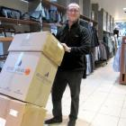 Country Road manager Jeff Hayes begins moving stock out of the shop as Lake Wakatipu levels rose...