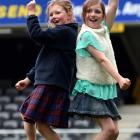 Cousins Lily and Lucy Woodhouse (both 9) dance on the pitch at the sound check. Photos by Peter...
