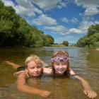 Cousins Molly and Jessica Lynch (both 8) cool  in the shallows of the Taieri River at Outram Glen...