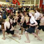 Cr Lee Vandervis (rear, second from left) watches pupils from the Waikouaiti Primary School kapa...