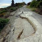 Cracks and slumps on the closed section of Haven St. Photo by Bill Campbell.