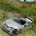 This rental car, driven by an Australian man, crashed down a steep bank below the Gibbston...