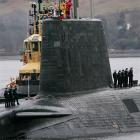 Crew from HMS Vengeance, a British Royal Navy Vanguard class Trident ballistic missile submarine,...