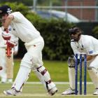 Neil Broom ( Otago) plays defensively as Northern Districts wicketkeeper Peter McGlashan watches...