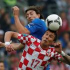 Croatia's Mario Mandzukic (R) vies for the ball with Italy's Riccardo Montolivo during their...