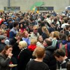 Crowds mingle and munch during the 2013 Port Chalmers Seafood Festival.