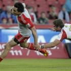 Crusaders winger Zac Guildford, left, avoids a tackle from Jaco Taute, of the Lions, during their...