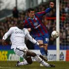 Crystal Palace's Alan Lee, centre, tackles Aston Villa's Emile Heskey during their fifth round FA...