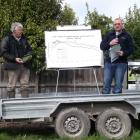 DairyNZ developer Steve Lee (left) watches while Lincoln University Dairy Farm manager Peter...