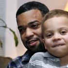 Damon Brown sits with his son Julian, 5, at their home in Seattle. Damon found a kidney on...
