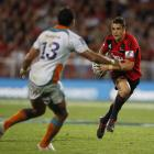 Dan Carter of the Crusaders runs at Robert Ebersohn of the Cheetahs during their Super 15 match...