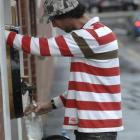 Dan Roberts fills his bottles  from the Speight's Brewery water tap yesterday. Photo by Linda...