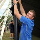 Daniel Adam, of Outram, helps put up a marquee for the Out West Cavalcade  this weekend. Photo by...