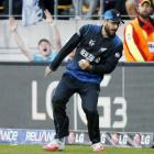 Daniel Vettori looks where his feet are on the boundary after taking the catch to dismiss West...