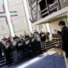David Burchell rehearses the male singers of the City of Dunedin choir in 'Four Little Prayers of...