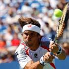 David Ferrer of Spain hits a return to Kevin Anderson of South Africa during their men's singles...