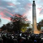 Dawn breaks over thousands of people at Queens Gardens in Dunedin. Photo by Craig Baxter.