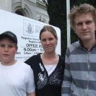 Debbie Devon and sons Jesse (13) and Andrew outside the Oamaru courthouse after yesterday's drink...