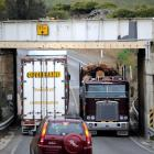 There is not much clearance when two trucks pass under the Deborah rail overbridge just south of...
