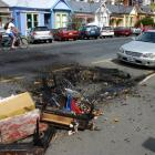 Debris from couch fires on Dundas St in October last year. Photo by ODT files