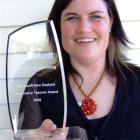 Deidre Senior with the trophy she was awarded at a national conference in Christchurch recently. ...