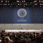 Delegates follow the opening of the Climate Conference in Copenhagen, Denmark, Monday, December 7...