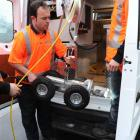 Delta CCTV operator Matt Peoples prepares to lower the company's new pipe inspection camera into...