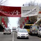 Delta workers remove the Otago Festival of the Arts banner from George St, Dunedin, yesterday...