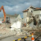 Contractors demolish a building on Highgate this week to make way for a $1.2 million restaurant....