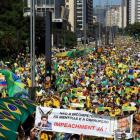 Demonstrators attend a protest in Sao Paulo's financial centre against Brazil's President Dilma...