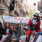 Demonstrators hold a banner during a protest against Syria's President Bashar al-Assad after...