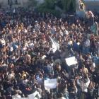 Demonstrators protest against Syria's President Bashar al-Assad after Friday prayers in Homs....