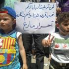 Demonstrators protest against Syria's President Bashar al-Assad after prayers in Maraa, near...
