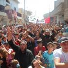 Demonstrators protest against Syria's President Bashar al-Assad, after Friday prayers in Sermada...