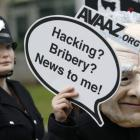 Demonstrators protest outside the News International offices in East London yesterday. REUTERS...