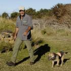 Department of Conservation senior technical support officer Scott Theobald and his terrier, Crete...